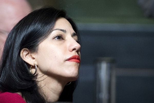 Huma Abedin listens during a speech by democratic presidential candidate Hillary Clinton at the 18th Annual David N. Dinkins Leadership and Public Policy Forum at Columbia University in New York April 29, 2015. REUTERS/Brendan McDermid  - RTX1AUYC